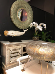 Morrocan tv unit / beaten metal side table / bronze morrocan mirror / whale sculpture