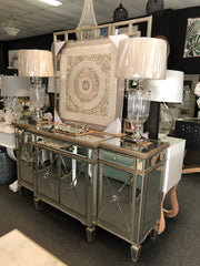 Mirrored console / Glass lamps / paper framed art