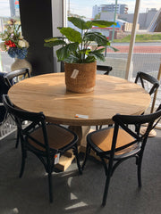 Reclaimed elm timber round dining table / black cross back chairs