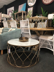Round marble coffee table / cane dining chair