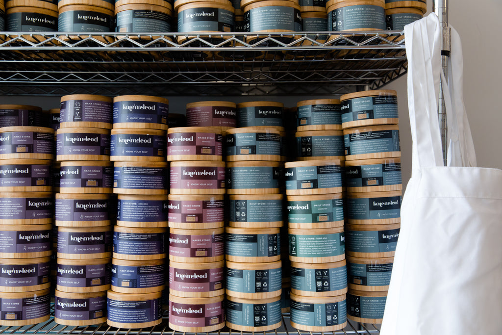 Stacks of our Body Stones in their reusable bamboo canisters