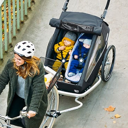 How to choose a bicycle trailer for children, what you need to know