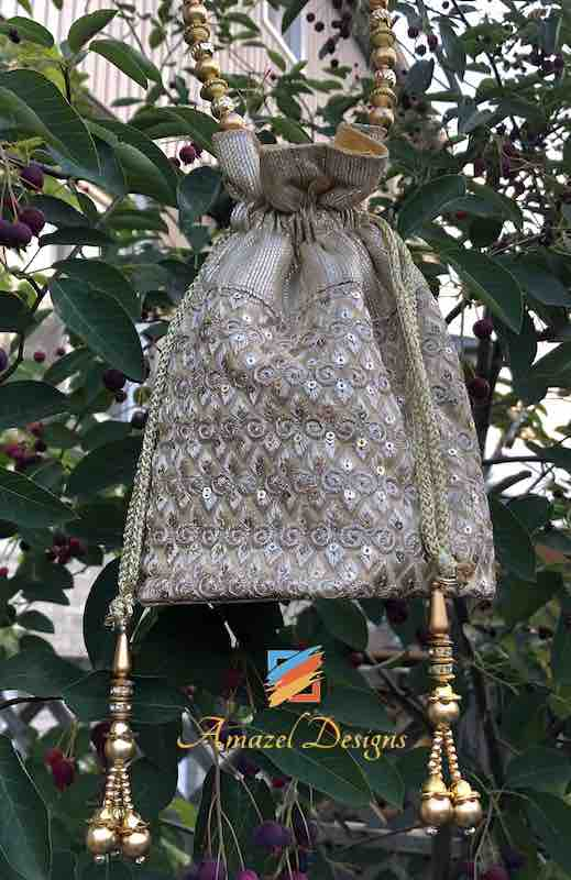 Silver And Skin Color Potli Bag
