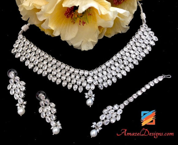 Splendid Silver Polki Necklace Earring Tikka Set