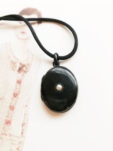 Antique Victorian black enamel and pearl mourning locket.