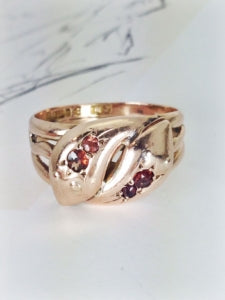 Antique garnet double snake rose gold ring