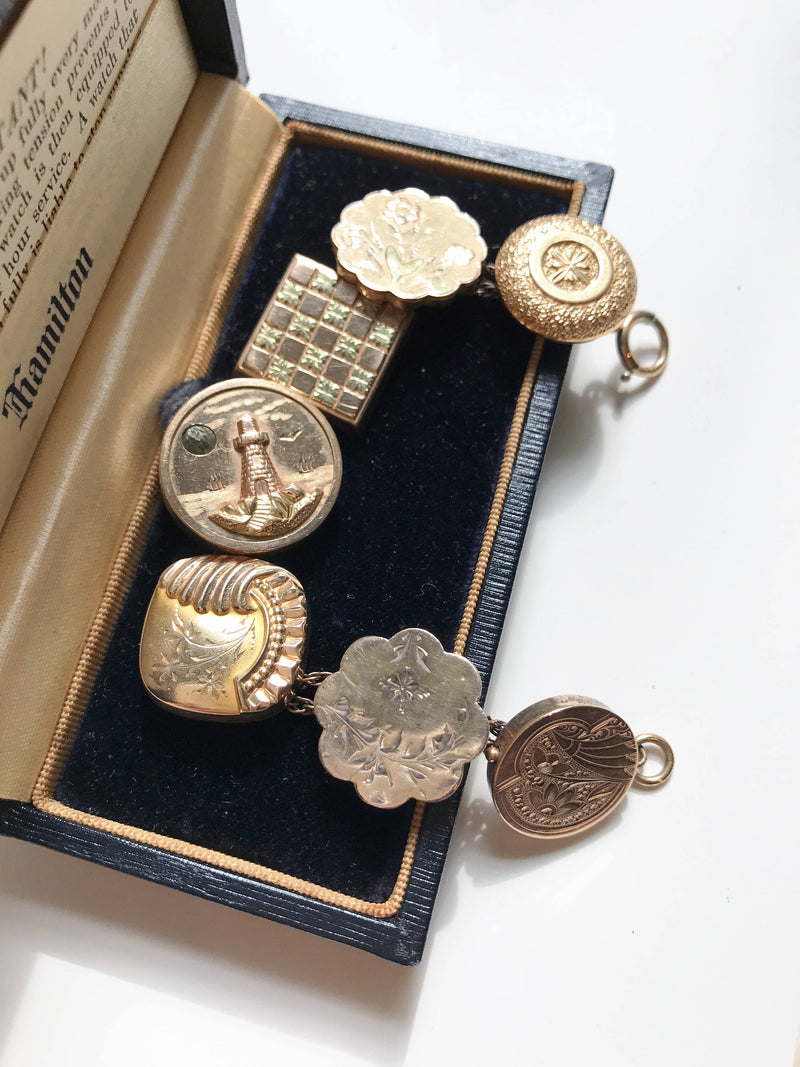 Antique bracelet | rare gold filled handmade folk art button charm | 1930's Art Deco jewelry | lighthouse, flower, checkerboard locket faces