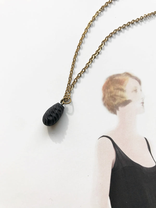 Victorian gutta percha necklace | vintage small black seed pod charm | gold filled necklace | mourning jewelry | young girl baby necklace