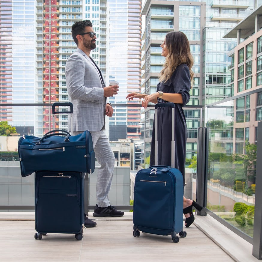 What's the Difference Between Spinner (4-Wheel) and Upright Rolling (2-Wheel) Luggage?