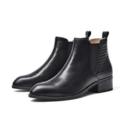 Autumn and winter leather European and American wind pointed flat boots