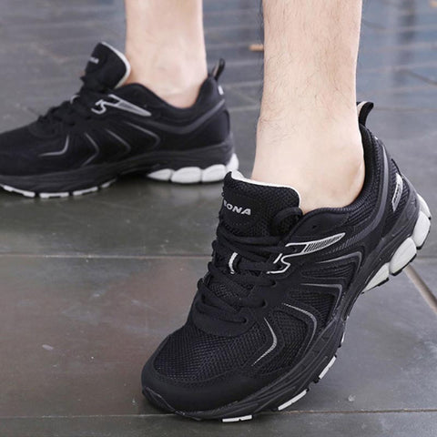 Autumn and winter new round head flat heel running shoes leather men's sneakers