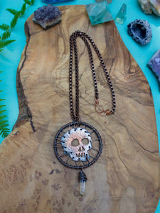 Hand-pierced Copper Skull Necklace with Clear Quartz Crystal