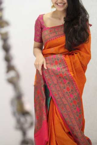 Amazing Orange Colored Soft Silk Party Wear Saree