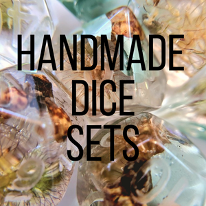 handmade resin dice sets for ttrpgs such as dungeons and dragons. handmade resin polyhedral dice sets.