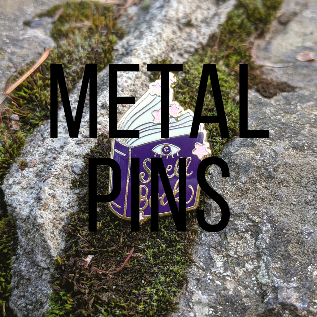 Metal pins that are dungeons and dragons themed. Nerdy TTRPG pins and gamer accessories.