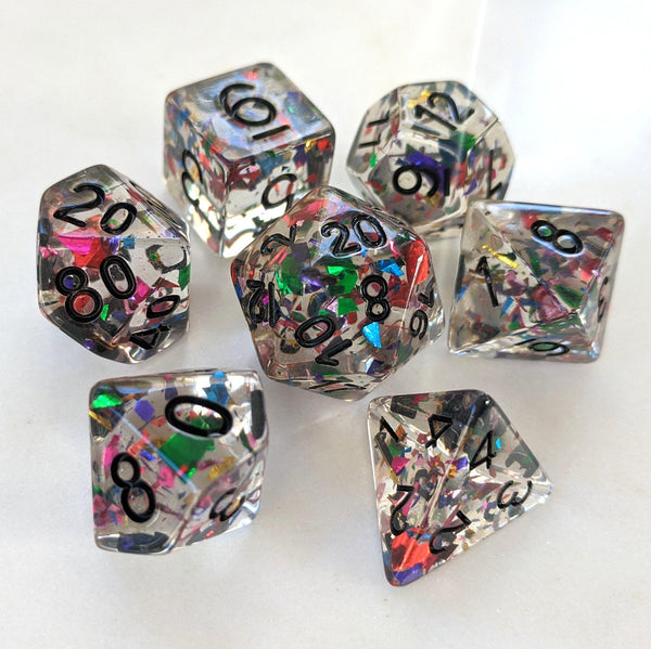 Masquerade Dice Set. Clear resin with rainbow confetti