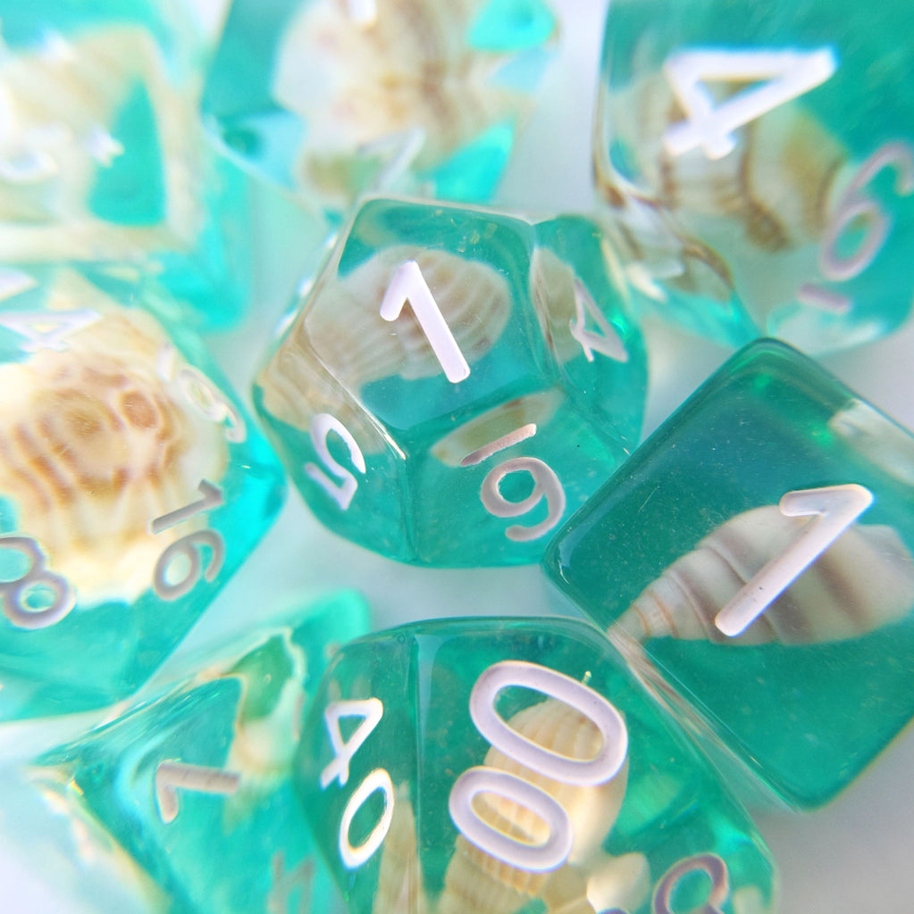 Sea Shell 8 Piece Dice Set. Real tiny sea shells sitting on a layer of teal glittering resin - CozyGamer