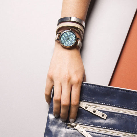 Ash Grey Leather Bracelet by TOKYObay. Women's double wrap leather bracelet in a pale color palette with feather charm. Fashion accessories for the everyday.