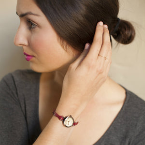 Eva Red womens petite watch style by TOKYObay. Vintage inspired petite dial with thin leather buckle strap.Classic style watch for the everyday.