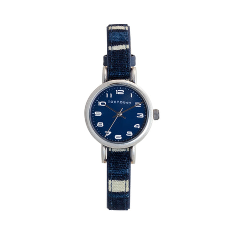 Petite Indigo women's watch by TOKYObay.Slide through strap made of traditionally dyed Japanese lines indigo fabric,full numbered dial. Petite watch style.