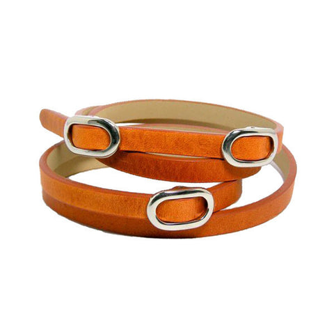 Triple Bracelet by TOKYObay. Soft orange leather double wrap bracelet with washed color pallet and oval buckle accents. Women's fashion accessories for the everyday.
