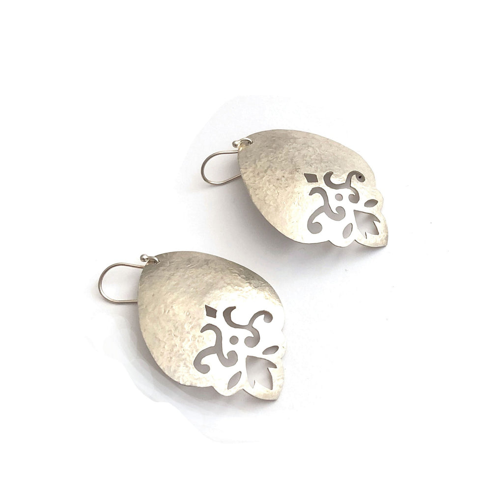 One off saw pierced and hammered sterling silver earrings