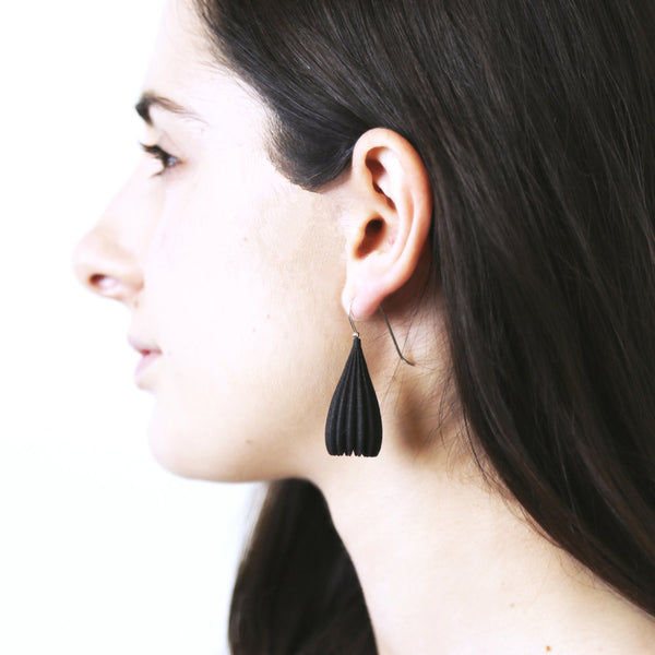 Jenny Fahey black pod earrings on the body.jpg