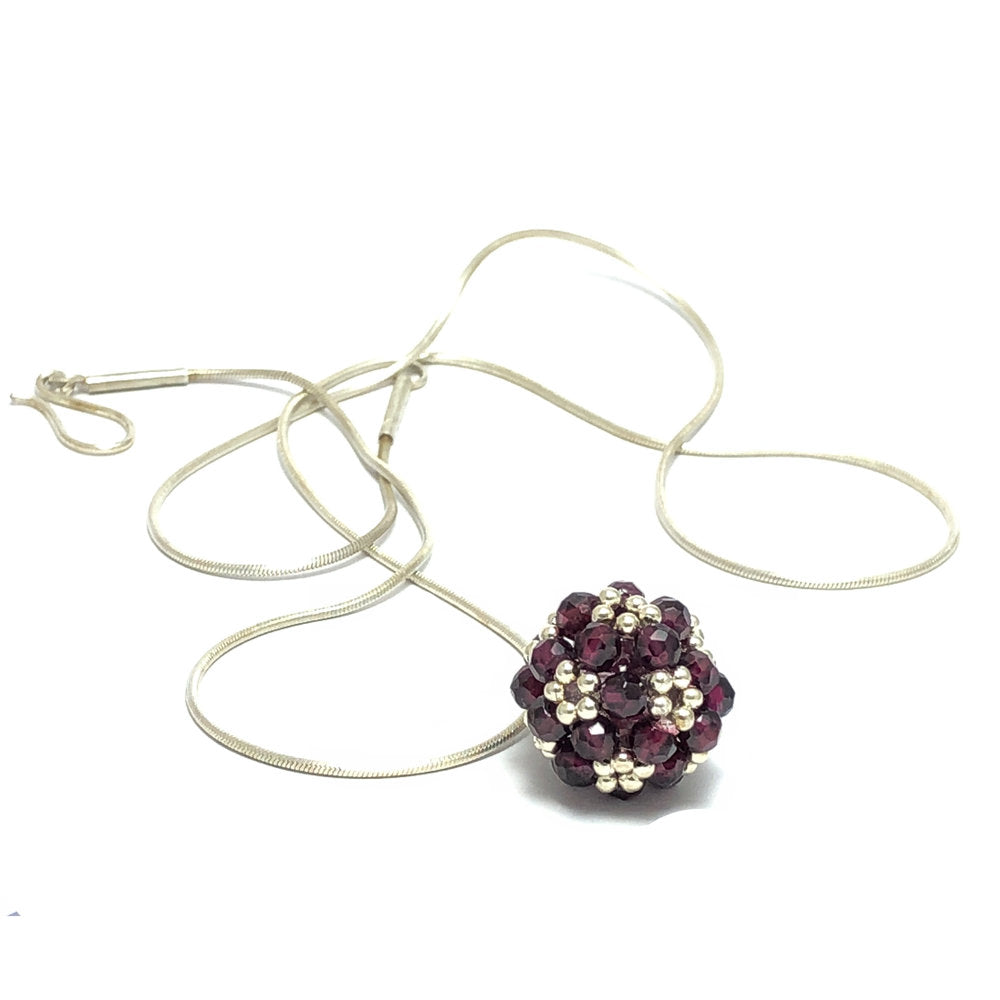 Jenny Fahey garnet large beaded ball necklace.jpg