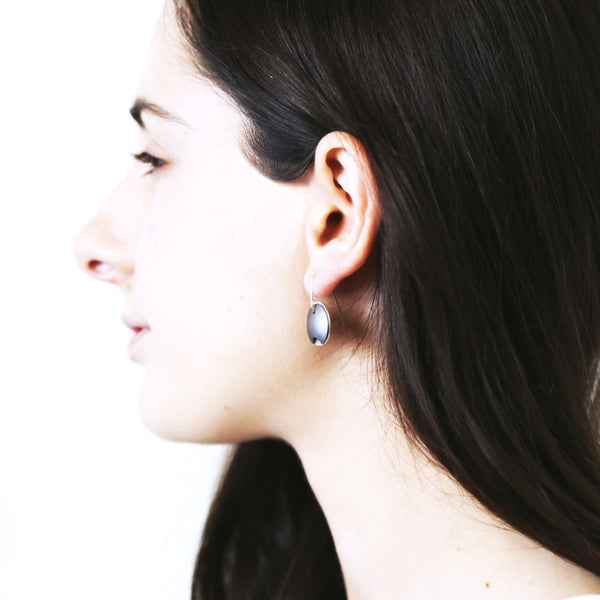 aluminium pod earrings on the body 2nd edit.jpg