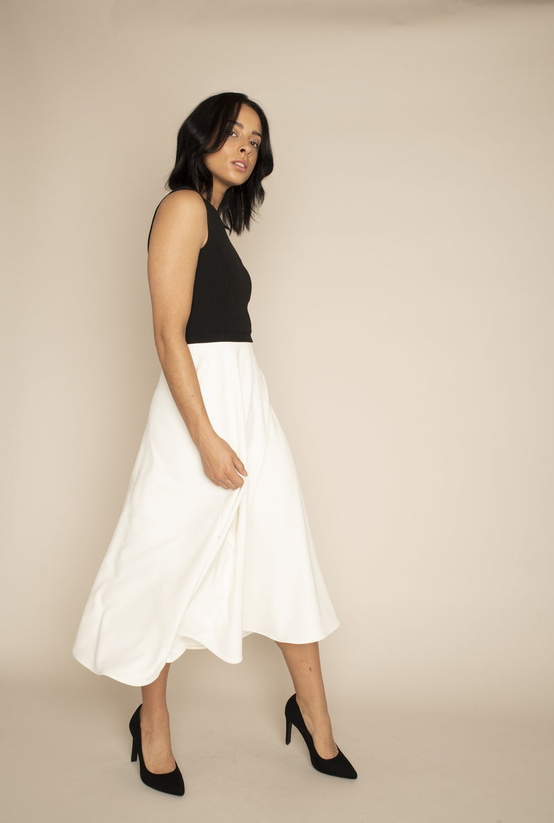 Black Sleeveless Eleanor Top with the Ivory Midi Elizabeth Skirt with our signature Careaux zip around the waist.