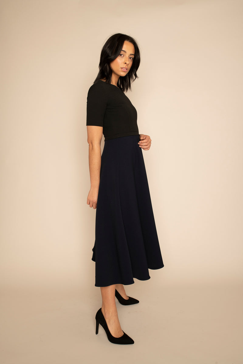 Black Sleeved Catherine Top with the Navy Midi Elizabeth Skirt with our signature Careaux zip around the waist.