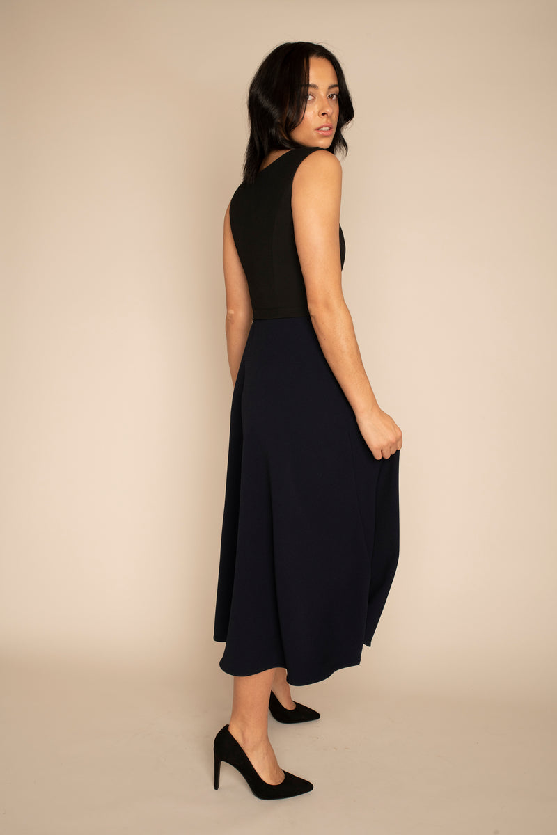 Black Sleeveless Eleanor Top with the Navy Midi Elizabeth Skirt with our signature Careaux zip around the waist.