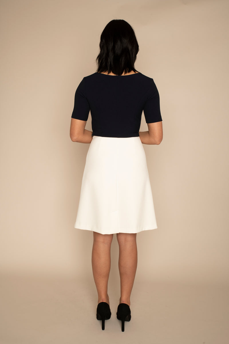 Back view of the Navy Sleeved Catherine top and the ivory a-line VICTORIA skirt with our signature Careaux zip around the waist.
