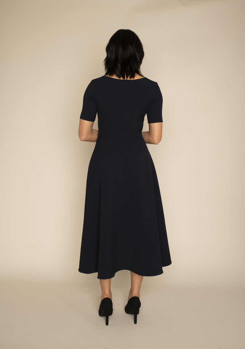 Back view of the navy sleeved Catherine top and the navy midi ELIZABETH skirt with our signature Careaux zip around the waist.