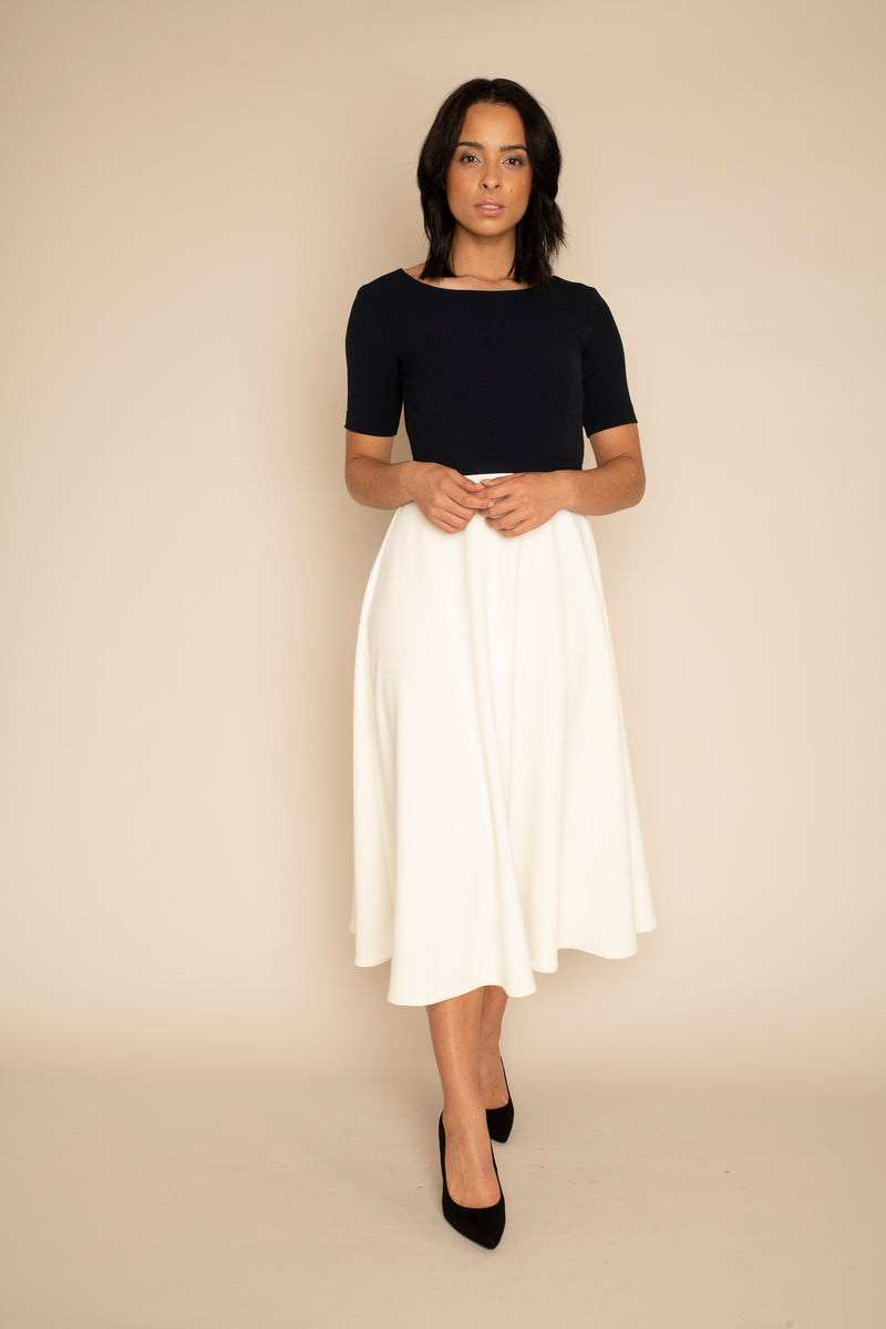 Navy sleeved Catherine top with the ivory midi ELIZABETH skirt with our signature Careaux zip around the waist.