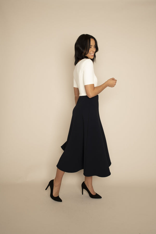 Ivory sleeved Catherine top with navy midi Elizabeth skirt with our signature Careaux zip around the waist.