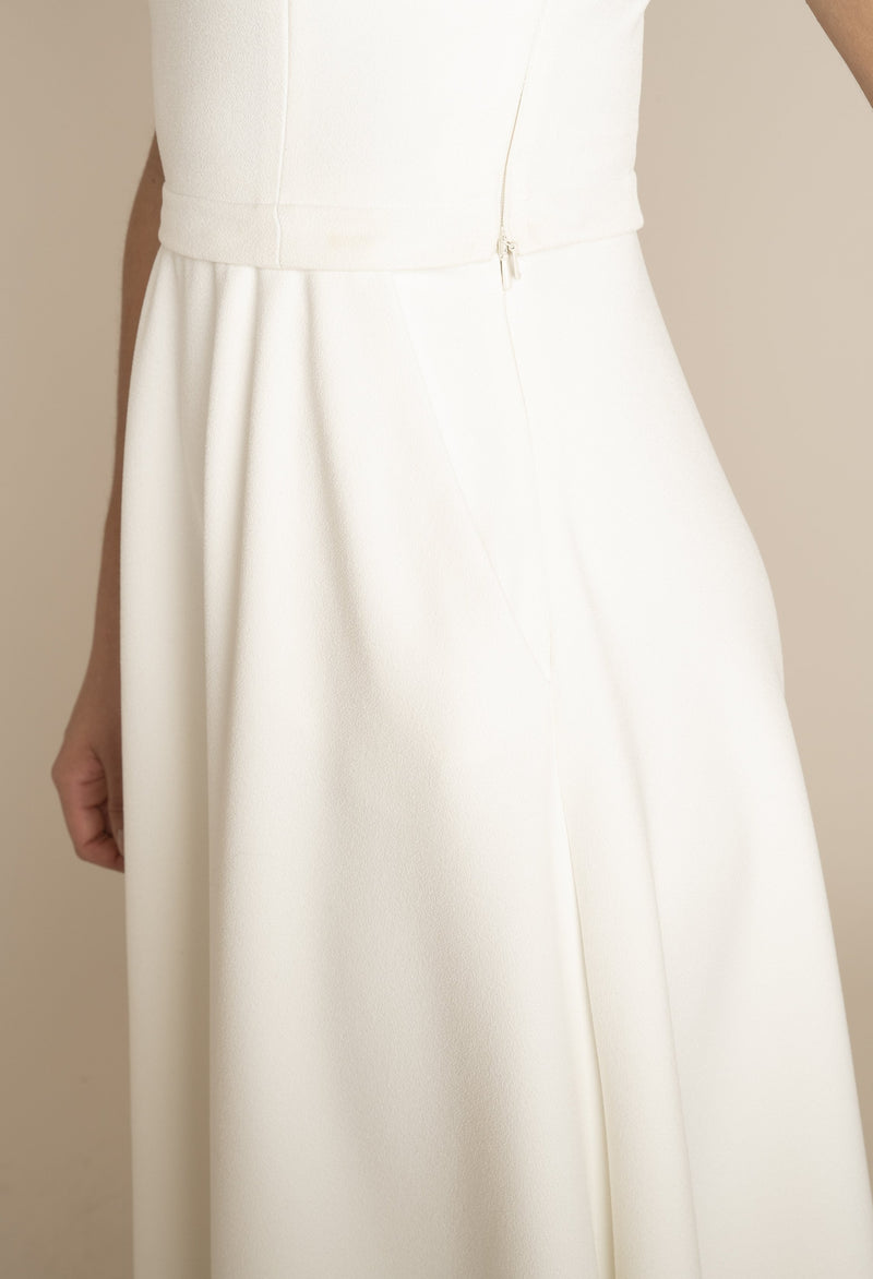 Close up of the side of Ivory Sleeveless Eleanor Top with the Ivory Midi Elizabeth Skirt with pockets with our signature Careaux zip around the waist.