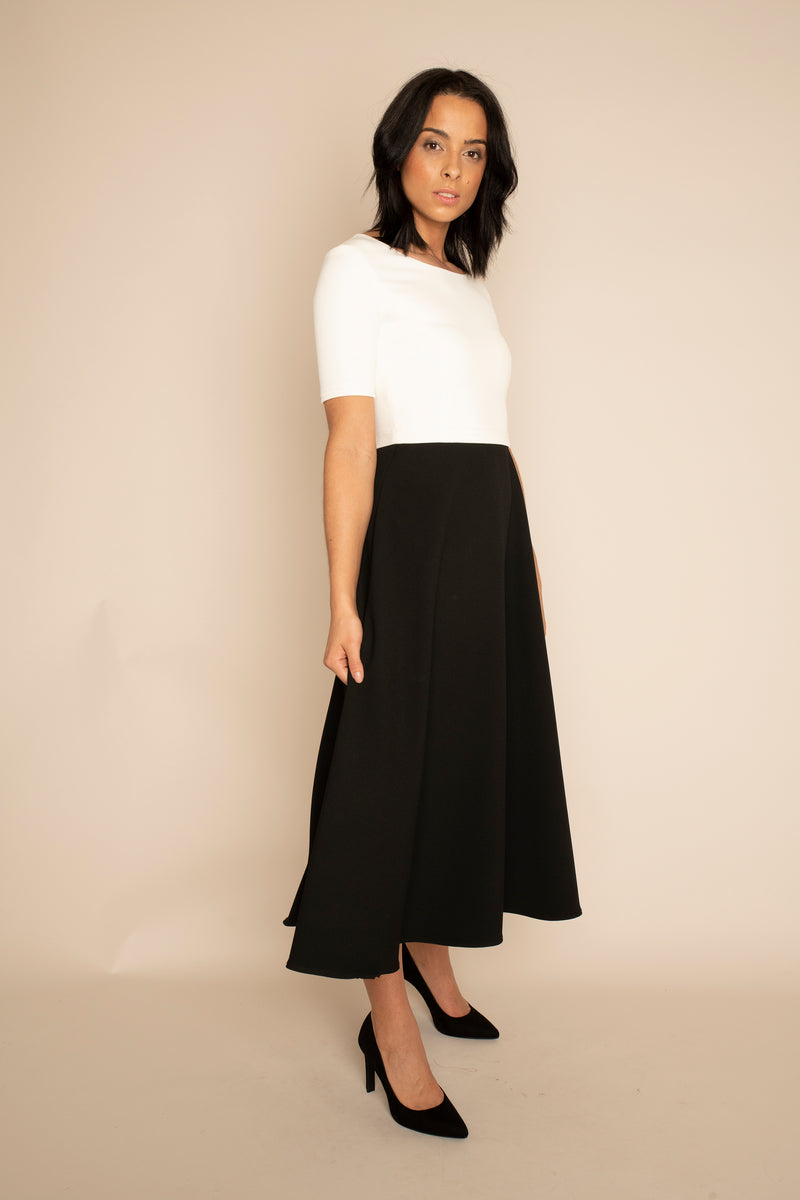 Ivory Sleeved Catherine Top with the Black Midi Elizabeth Skirt with our signature Careaux zip around the waist.