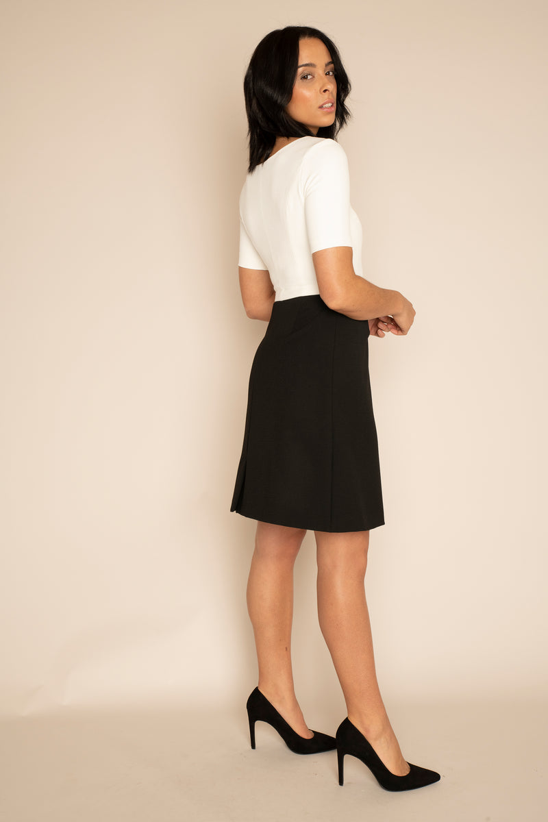 Ivory Sleeved Catherine Top with the Black A-Line Victoria Skirt with our signature Careaux zip around the waist.
