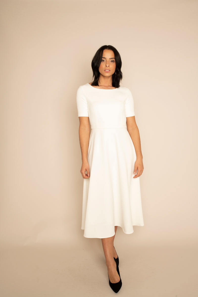 Ivory Sleeved Catherine Top with the Ivory Midi Elizabeth Skirt with our signature Careaux zip around the waist.