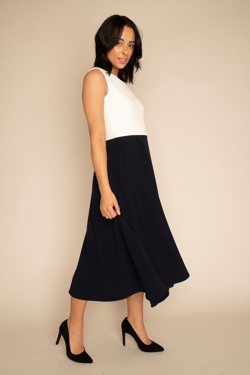 Ivory Sleeveless Eleanor Top with the Navy Midi Elizabeth Skirt with our signature Careaux zip around the waist.