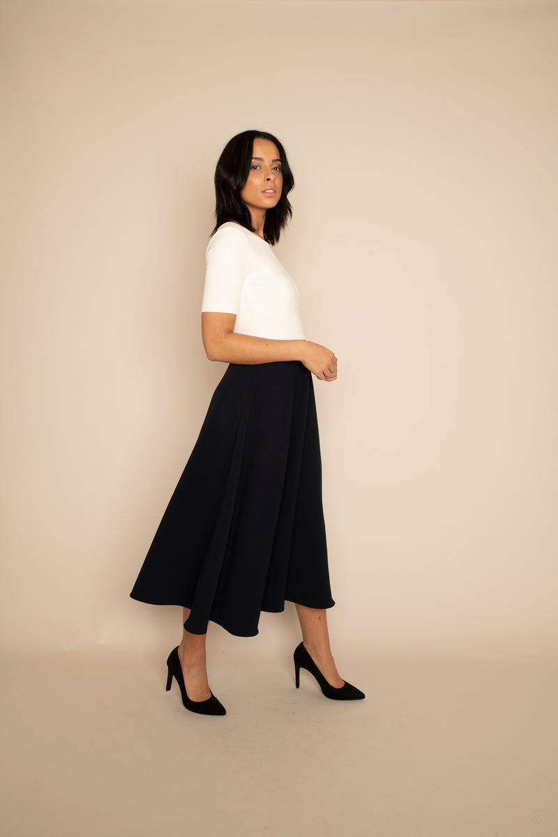 Ivory Sleeved Catherine Top with the Navy Midi Elizabeth Skirt with our signature Careaux zip around the waist.