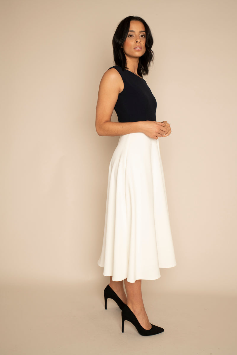 Navy Sleeveless Eleanor Top with the Ivory Midi Elizabeth Skirt with our signature Careaux zip around the waist.