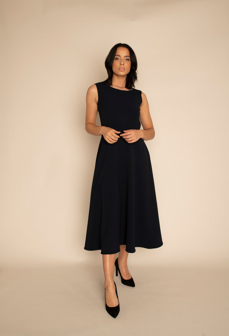 Navy Sleeveless Eleanor Top with the Navy Midi Elizabeth Skirt with our signature Careaux zip around the waist.