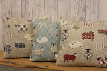 "Load image into Gallery viewer, Any one can cuddle but only the welsh can Cwtch- 16""Square Sheep in woolly jumpers  Cushion"