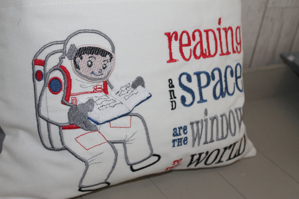 Book Cushion. Space man, Reading in space