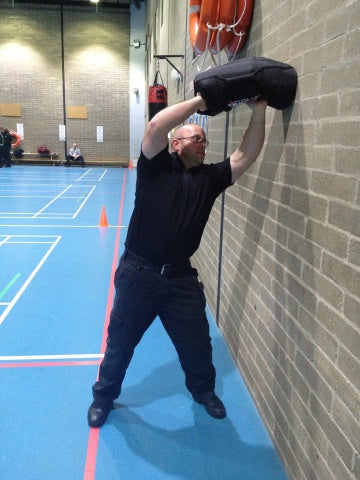 PC Daniel Sullivan, Specialist Trainer/ PTI at Bedfordshire Police puts a sandbag through its paces