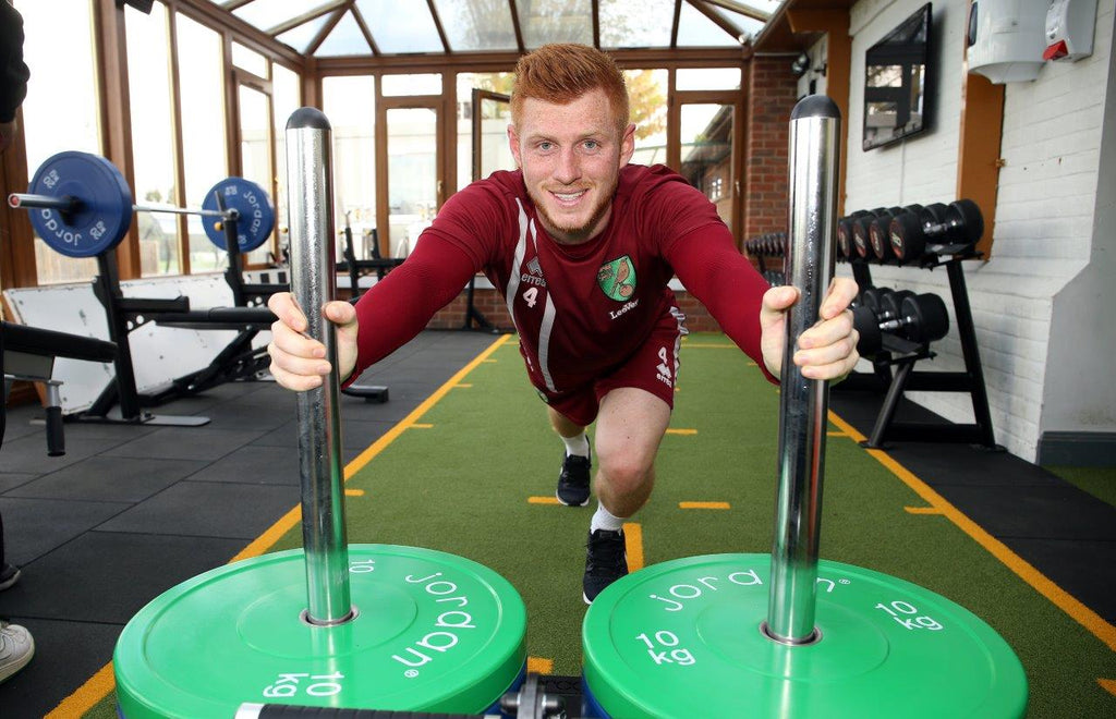 Porfessional Footballer Harrison Reed using the newly installed Jordan Fitness equipment at the Norwich City Football Club gym