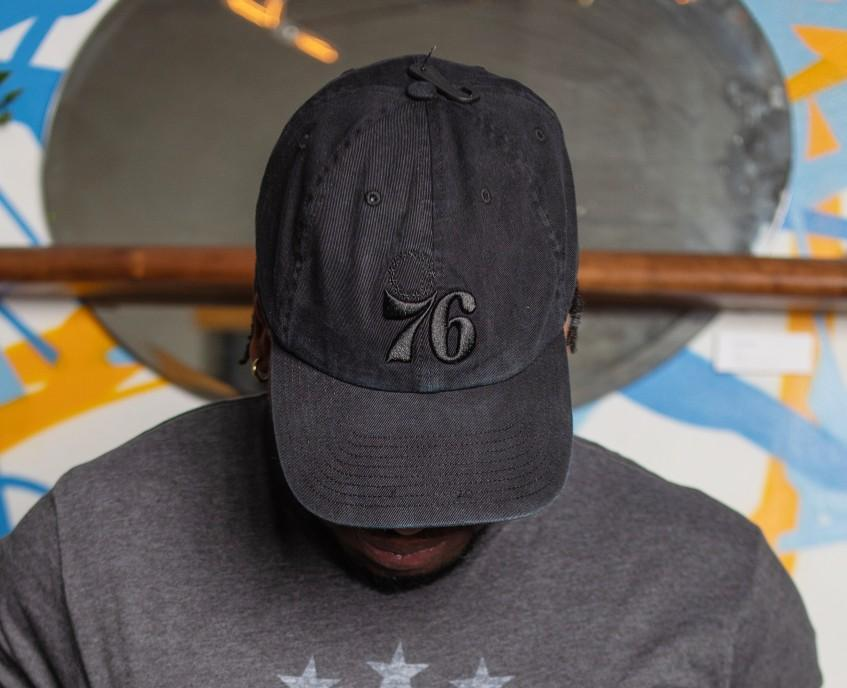 Philadelphia 76ers Black On Black Clean Up Logo Hat