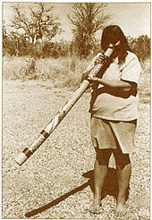 aboriginal woman playing the didgeridoo